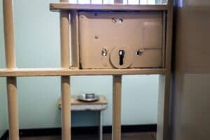 an image of a jail representing the difference between rehab vs jail