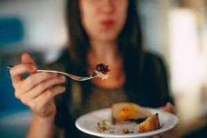 an image of a person eating who overcame an eating disorder and addiction