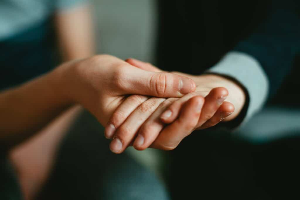 an image of people holding hands representing contingency management