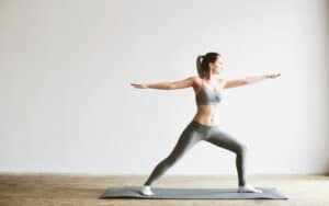 an image of a woman doing yoga increasing her dopamine levels