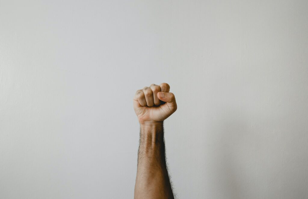 an image of a fist from someone learning how to fight addiction