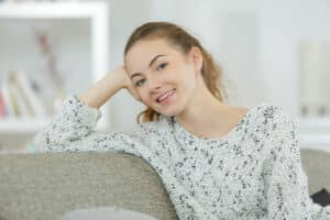 an image of a woman thinking about inpatient vs outpatient treatment