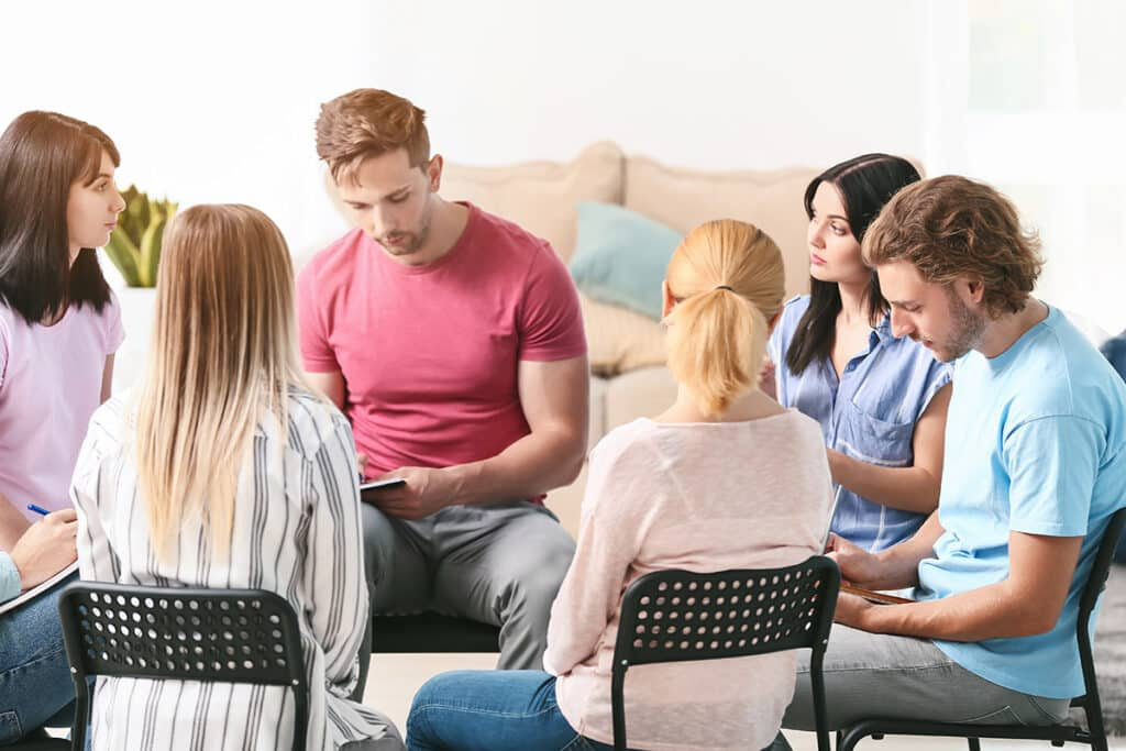 an image of people learning the differences between inpatient and outpatient treatment