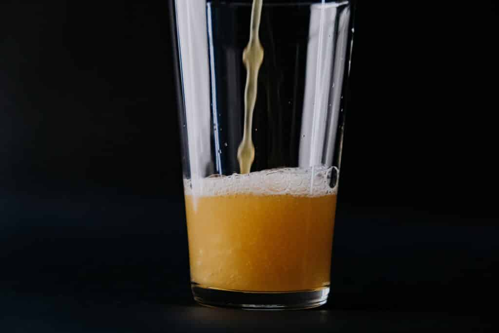 """an image of beer being poured and someone asking """"am i an alcoholic?"""""""